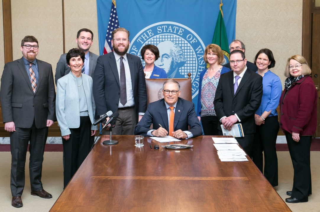 Pictured left to right: Curt Kohlwes, Executive Legislative Assistant, Marilyn Cohen, NW Center for Media Literacy, College of Education, UW, Evan Smith, Legislative Assistant, Sen. Marko Liias 21st District-Lynnwood, Carolyn Logue, Washington State Library Association, Governor Jay Inslee, Sharyn Merrigan, Teacher Librarian, Olympia School District, Dennis Small, Educational Technology Director, Office of Superintendent of Public Instruction, Nick Pernisco, Action for Media Education, Jessica Vavrus, Washington State School Directors' Association and Barbara Johnson, Action for Media Education.