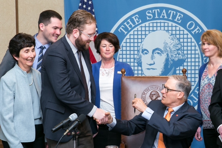 Gov. Inslee gives the bill signing pen to Sen. Marko Liias, the primary sponsor of the bill. Pictured left to right: Marilyn Cohen, NW Center for Media Literacy, College of Education, UW, Evan Smith, Legislative Assistant, Sen. Marko Liias 21st District-Lynnwood, Carolyn Logue, Washington State Library Association, Gov. Jay Inslee and Sharyn Merrigan, Teacher-Librarian, Olympia School District.