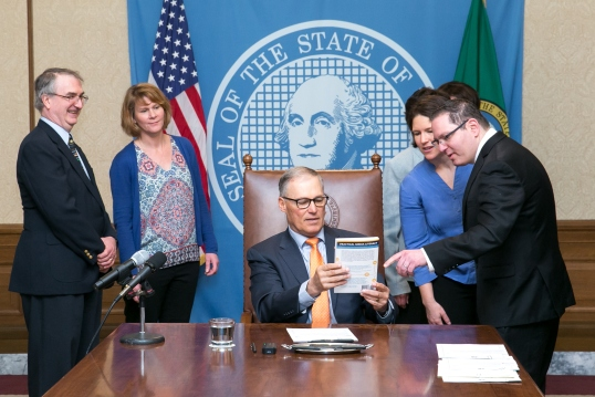 Nick Pernisco gives Gov. Jay Inslee a copy of Nick's book Practical Media Literacy. Pictured left to right: Dennis Small, Educational Technology Director, Office of Superintendent of Public Instruction, Sharyn Merrigan, Teacher-Librarian, Olympia School District, Gov. Jay Inslee, Jessica Vavrus, Washington State School Directors' Association and Nick Pernisco, Action for Media Education.