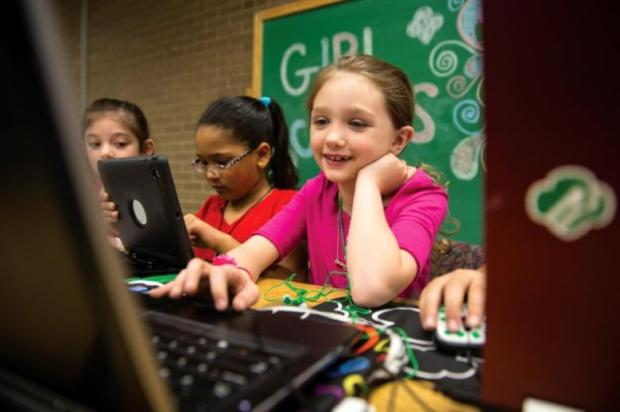 A Girl Scout works on a laptop, as the Girl Scouts of the USA introduce 18 new Cybersecurity badges